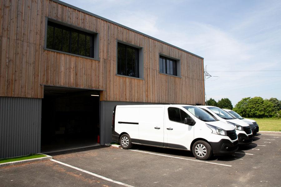Commercial Auto Insurance - Fleet of Vans Outside of a Loading Dock