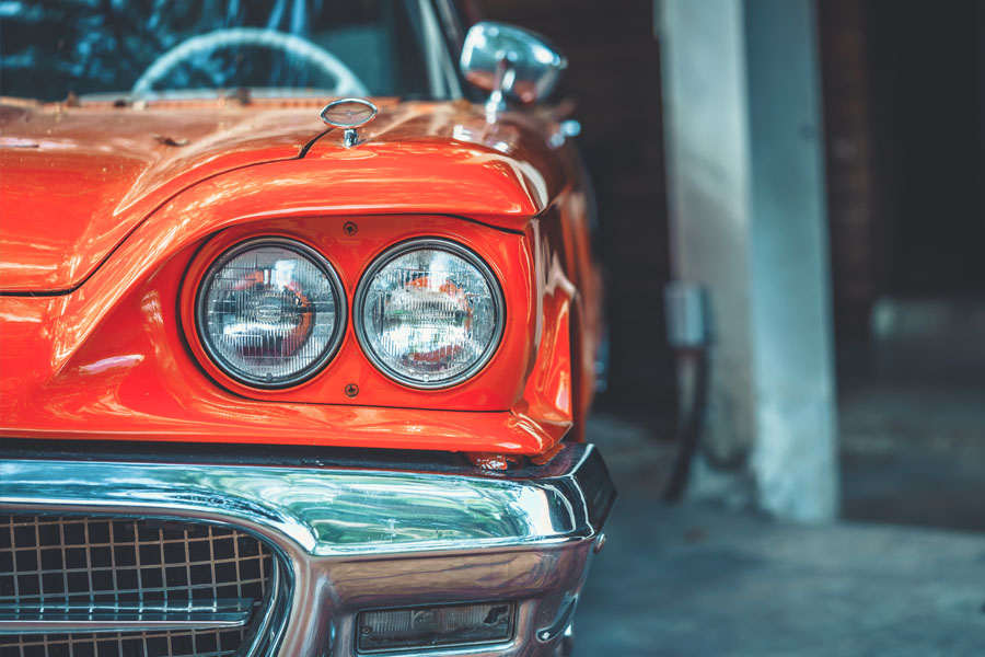 Antique and Classic Car Insurance - Classic Red Car in a Garage